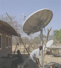 VSAT installer at work in Kenya, Africa