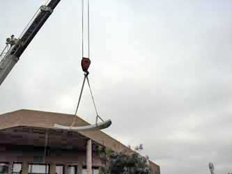 Using crane to lift the antenna reflector panels