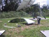 Assembling the antenna dish reflector panels requires great skill.  The outer ring must be flat to 3mm for C band operation