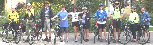 Group of us 9 guests and Marietta, with our bicycles, ready to start on our cycle tour of Hungary