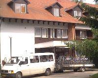 Hotel Touring in Berekfurdo with our cycles and back up van waiting oputside