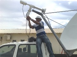 VSAT installer connecting up the C band LNB