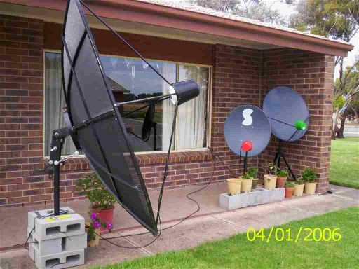 C band dish on a portable metal post mount pointing at INSAT 2E satellite to receive FTA TV channels from India