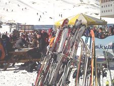 Skis stacked outside in the snow during lunch