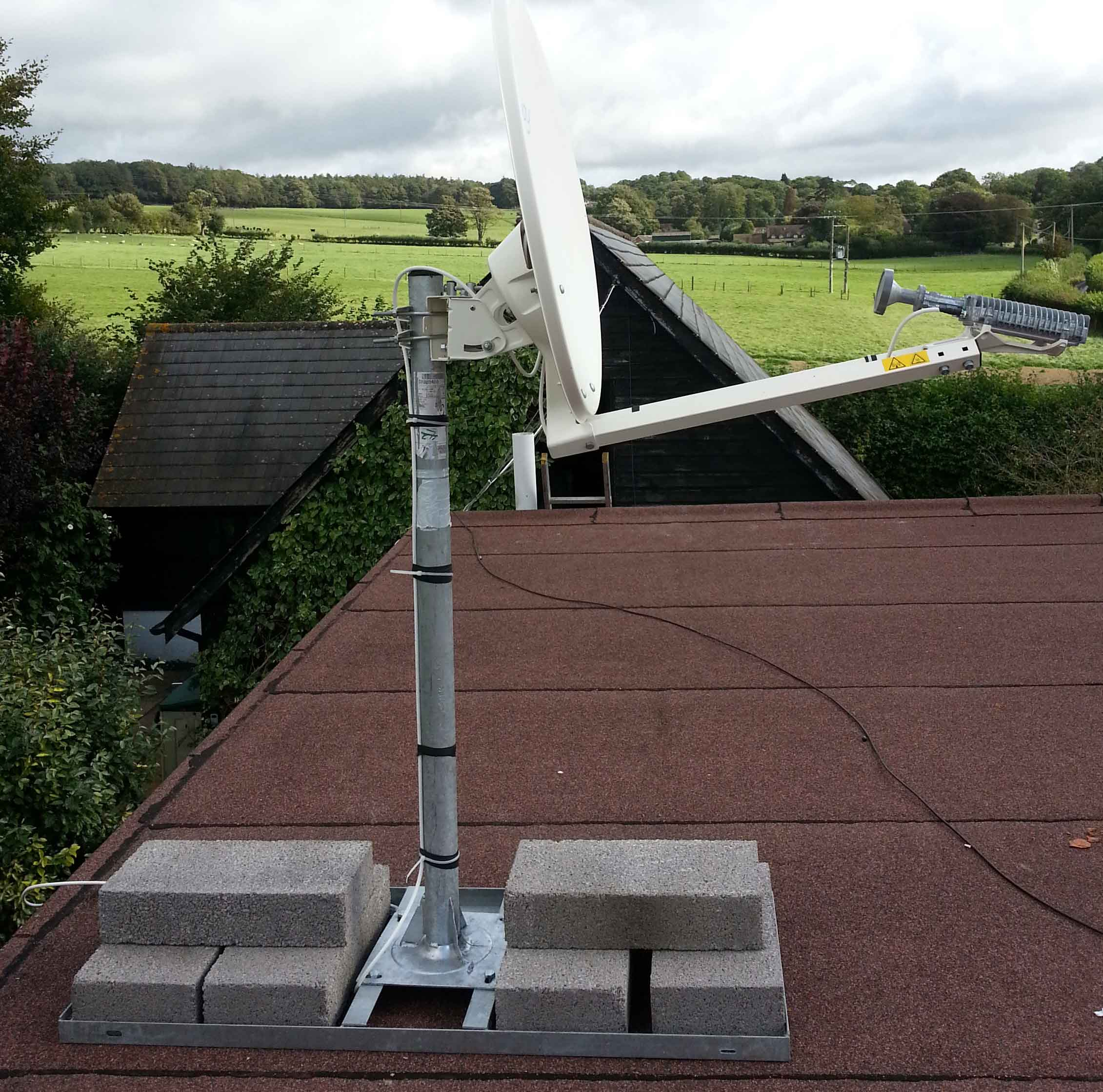 Tooway Satellite Dish Mounted On Flat Roof. Non Penetrating Roof Mount
