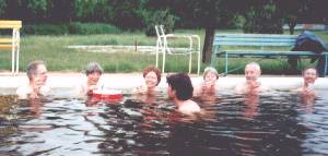 Drinking 'vitamins' in hot pool at Kunhegyes