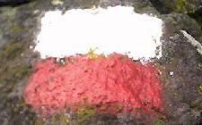 Grande Randonn?e GR70 red and white sign footpath mark