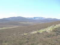 Views across scottish hills on clear sunny day walking.