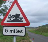 Sign at Glengarden warning of abnormal humped bridge on the A939 road at Rinloan.