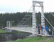 Pedestrian suspension bridge over the river Dee which wobbled from side to side.